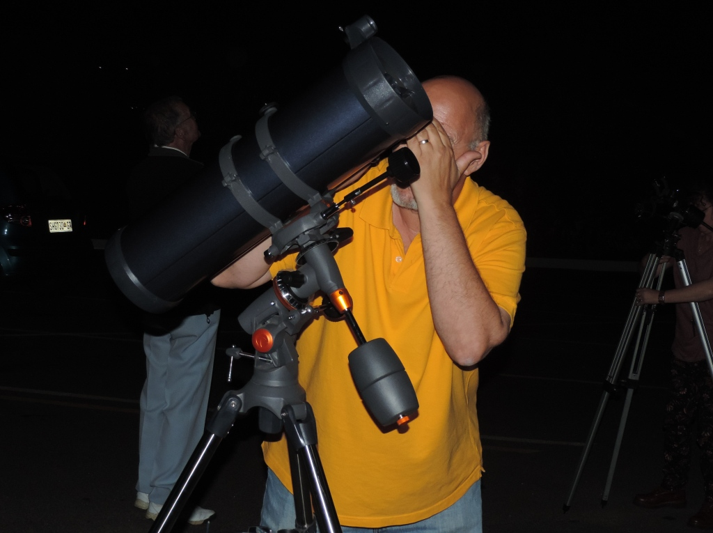 David sets up one of the telescopes for viewing