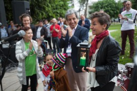 Christina Figueres of the UNFCC holds a green candle at the interfaith climate vigil